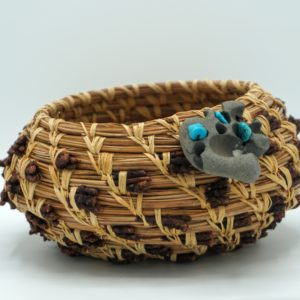 Handwoven Pine Needle Basket With A Turquoise Stone